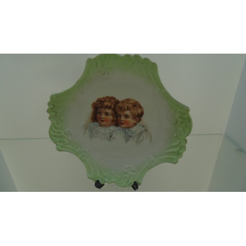 142 - Decorative plate of two young children...