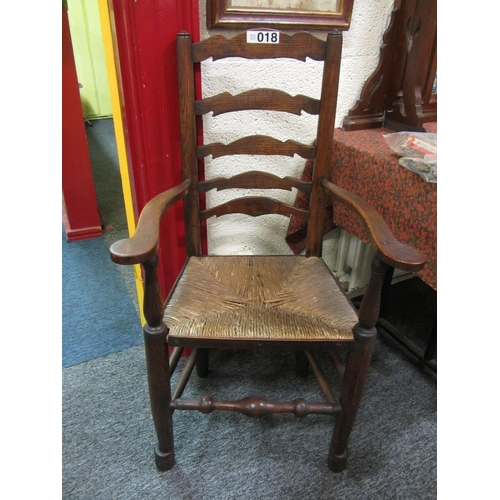18 - Good victorian ladder back rush seat country armchair....