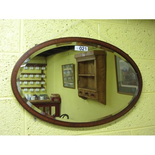 21 - Victorian mahogany inlaid over beveled mirror....