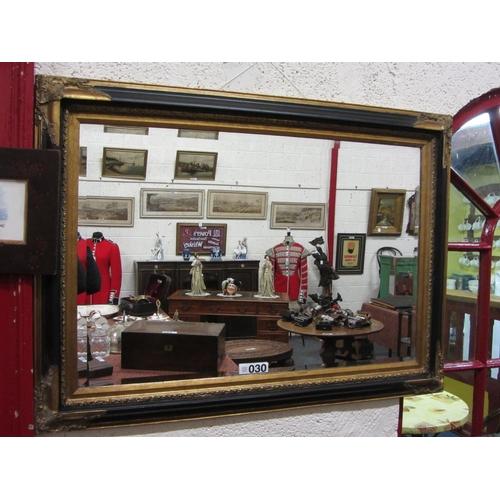 30 - Ebonised and gilt over mantel beveled mirror. 80cm x 108cm....