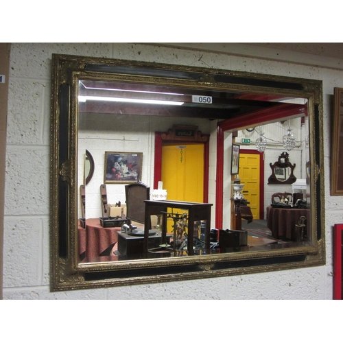 50 - Ebonised and gilt over mantel mirror.  108cm x 75cm....