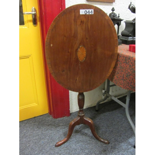 44 - Victorian mahogany oval tip up table on pod.  Top:57cm x 46cm....