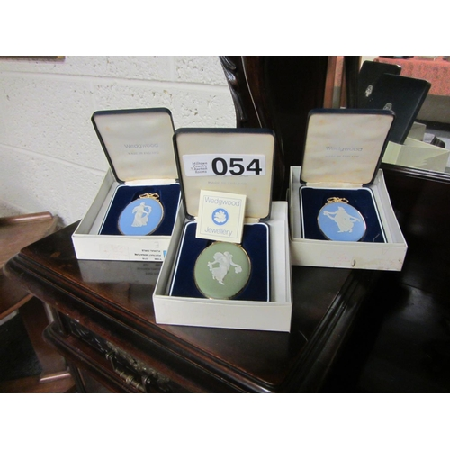 54 - 3 boxed Wedgwood pendents....