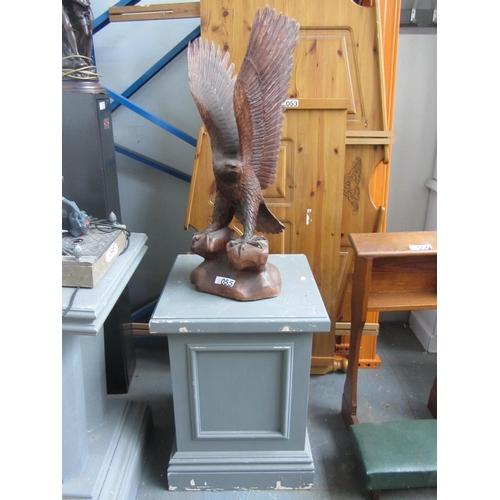 55 - American wood carved eagle on pedestal....