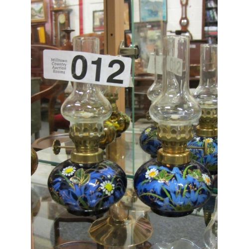 12 - Pair of miniature hand painted oil lamps. H:14cm...