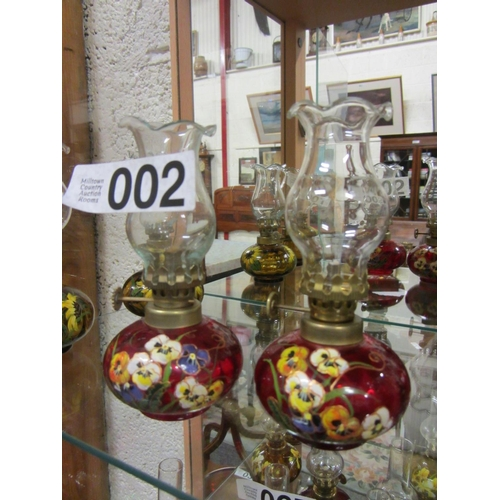 2 - Pair of miniature  hand painted oil lamps H:14cm....