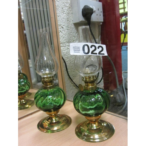 22 - Pair of green glass oil lamps on brass base. H:29cm...