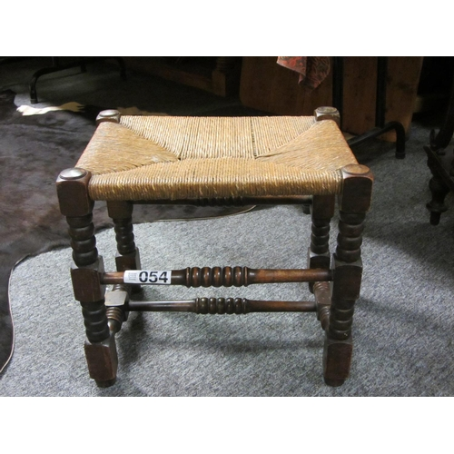 54 - Good carved oak foot stool with wicker seat....