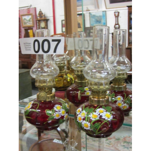7 - Pair of miniature hand painted oil lamps. H:14cm....