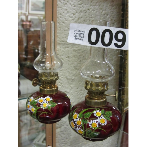 9 - Pair of miniature hand painted oil lamps. H:14cm....