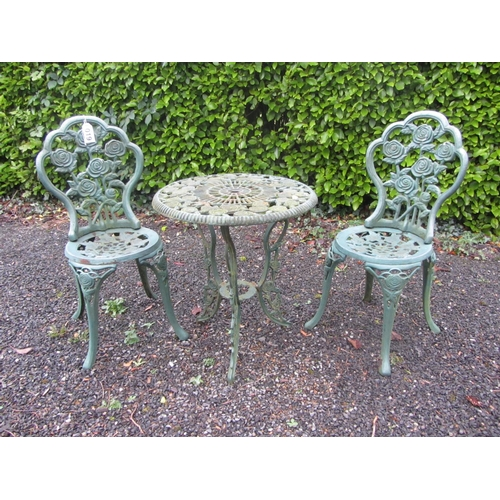 19 - Cast iron garden table and chairs....
