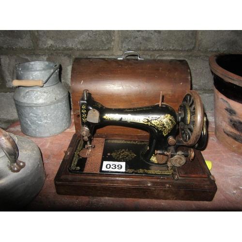 39 - Singer sewing machine in case....