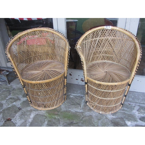 11 - Pair of wicker work tub chairs.