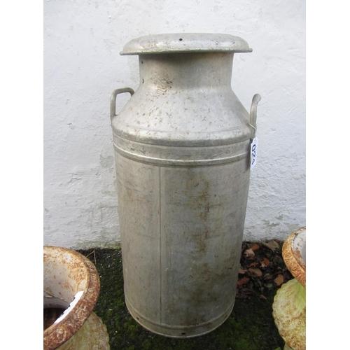 24 - Antique aluminium can.
