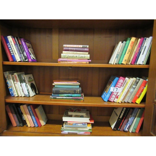 17 - Assorted books in bookcase.