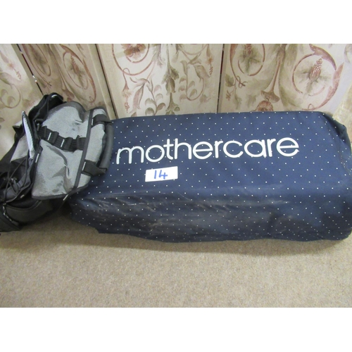 14 - Mother care travel cot plus rack sack.
