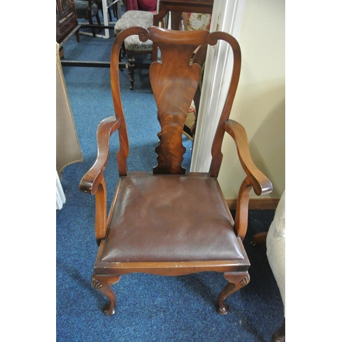 21 - An antique carver/ library chair with elegant design....