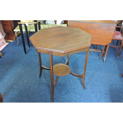 22 - An antique/ Edwardian octagonal topped occasional table with inlaid design....