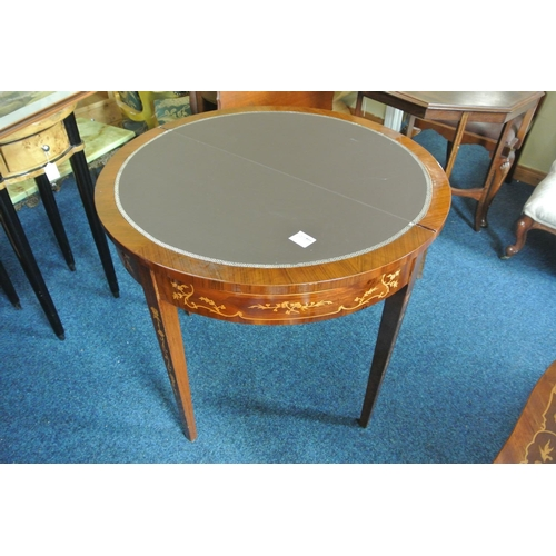 23 - A stunning antique style inlaid turnover table, with decorative design....