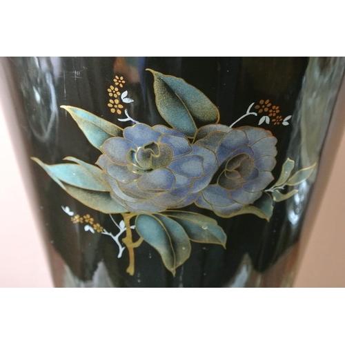 28 - A large ceramic stick/ umbrella stand with floral design (a/f)....