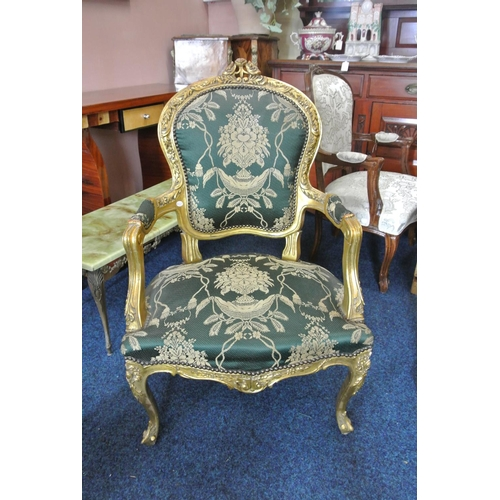 34 - An antique style gilt framed armchair with carved frame & new upholstery....