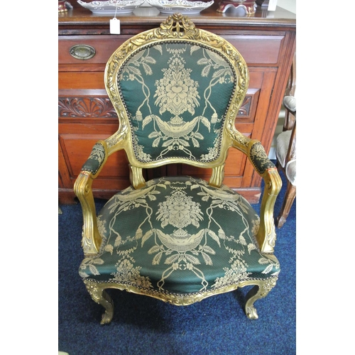 41 - An antique style gilt framed armchair with carved frame & new upholstery....
