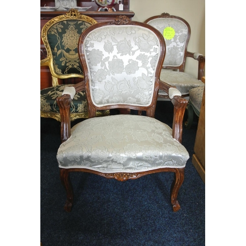 43 - An antique style armchair with carved frame & new upholstery....