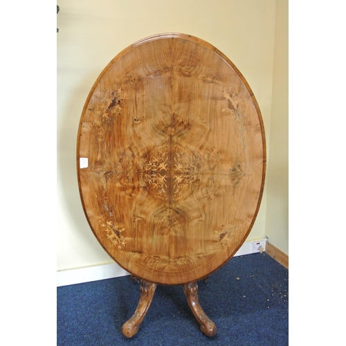 50 - A stunning antique/ Victorian oval tilt top breakfast table, with decorative inlaid design....