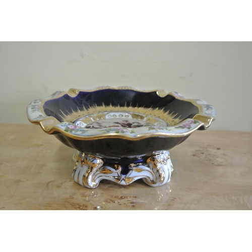 53 - An antique style ceramic ashtray, with decorative scene, produced by Reiter....