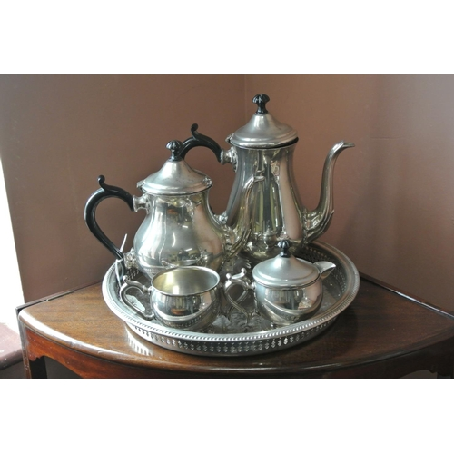 7 - An antique silver plated tea service with tray....