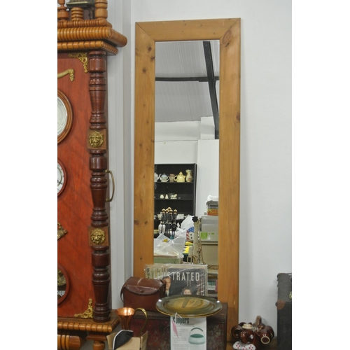 20 - A large pine framed mirror....