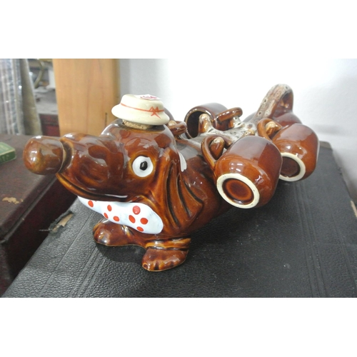 22 - A vintage ceramic Sake bottle/ decanter with 4 matching glasses, in the form of a Dachshund dog....