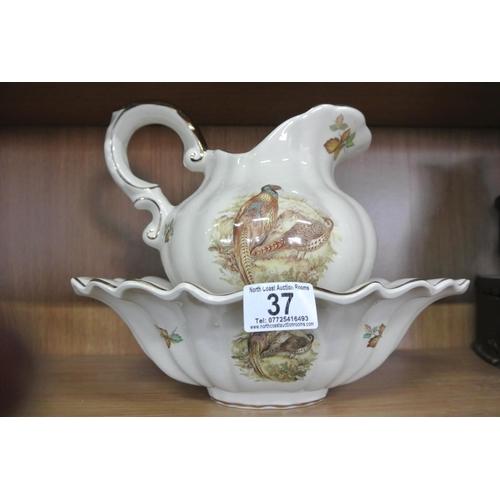 37 - A decorative Staffordshire Iron Stone ceramic jug & basin with pheasant design....