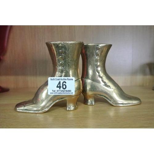 46 - A pair of antique brass boots....