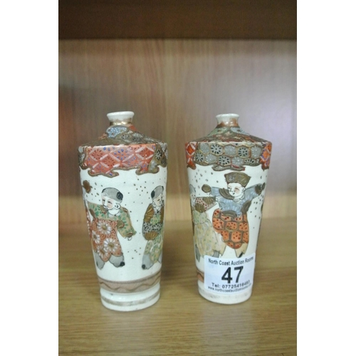 47 - A pair of antique Chinese/ Oriental vases with decorative scenes....