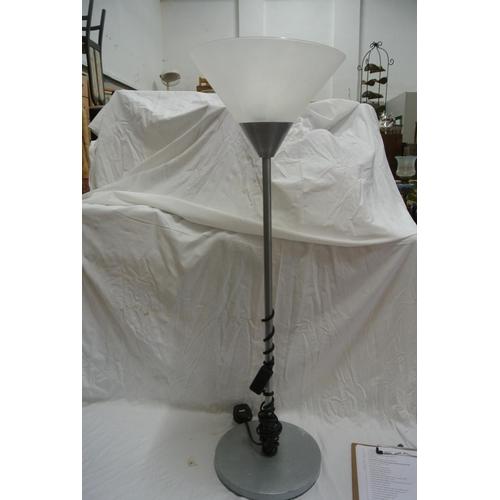 12 - A small modern floor lamp...