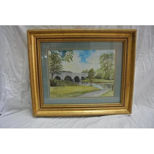 14 - A framed watercolour signed J E Holt...