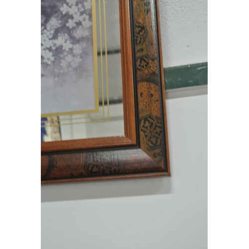 17 - A framed mirror backed print...