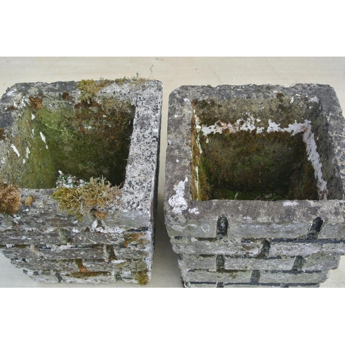 1a - A pair of concrete planters....
