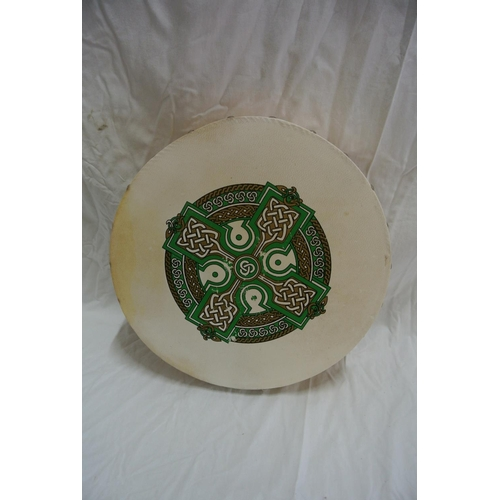24 - An Irish bodran drum with Celtic knot design...