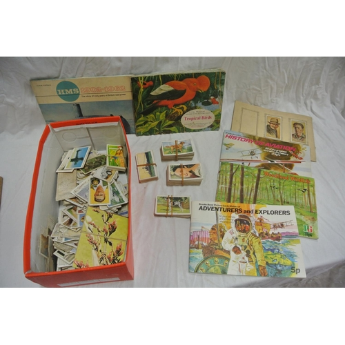 33 - A box of assorted cigarette cards...
