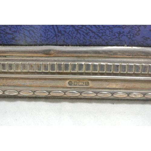 49 - A silver photo frame...