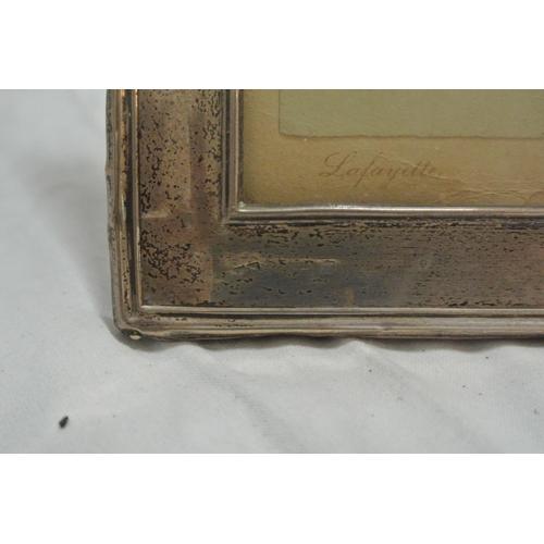 50 - A silver photo frame...