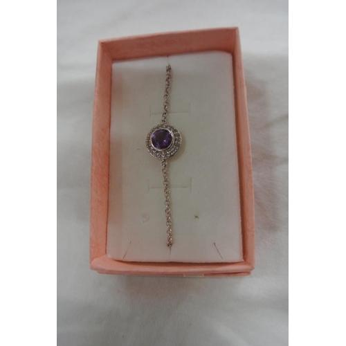 54 - A silver amethyst bracelet...