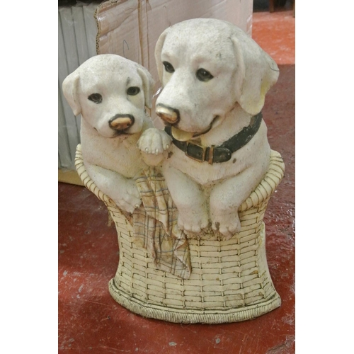 6A - A garden figurine dogs in a basket...
