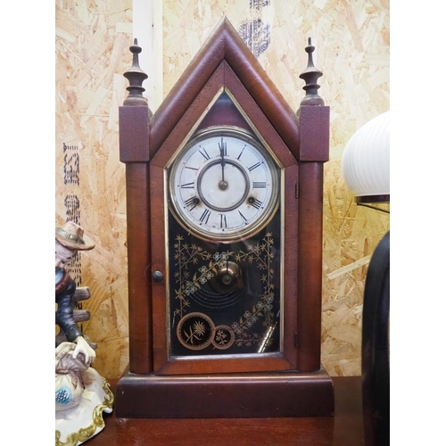 18 - An antique mantle clock....