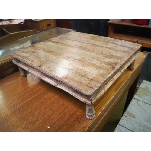 24 - A small wooden table....