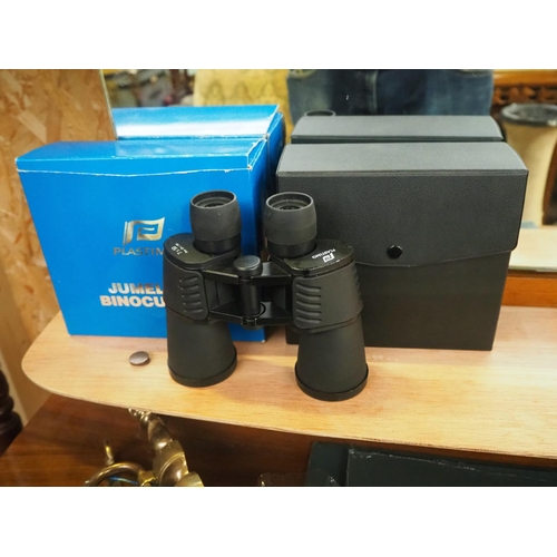 27 - A cased set of binoculars with original box....