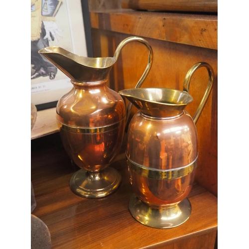 32 - 2 brass & copper jugs....