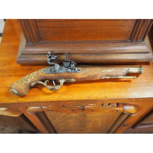 33 - A replica flintlock pistol....